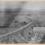 463-View showing dam, trestle, and concrete mixier. 1914.